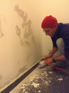 Peter repaints wall