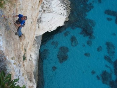 Sardinia climbing Peter seconding 7a pitch, Abissi, Falesia dei Falchi Cala Goloritz