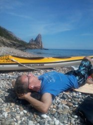 Peter on the lonely beach which you can only reach by sea canoa south of Pedra Longa, north of Santa Maria Navarrese