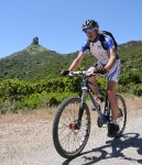 Marco rides near Perda 'e Liana on the route of the Mountain Bike Rally di Sardegna